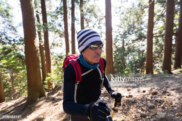 groups including seniors hiking up the mountain - long sleeved stock pictures, royalty-free photos & images