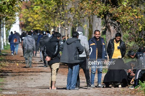Groups of African and Asian migrants are seen gathering in a park near migrants centers in NorthernBosnian town of Bihac on October 25 2018 In their...