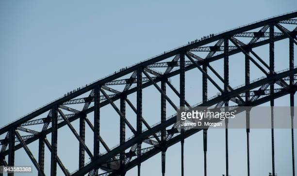 Groups of climbers on the Harbour Bridge on April 9 2018 in Sydney Australia Sydney has been experiencing unseasonably high temperatures for April...