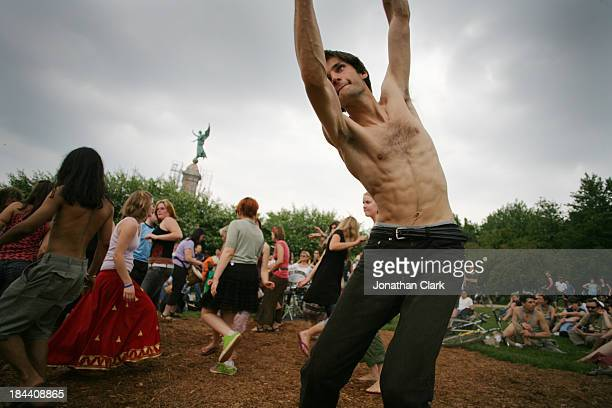 CONTENT] Groups of dancers at the Montreal Tam Tams that occur every Sunday during the summer in the Plateau Montreal Canada