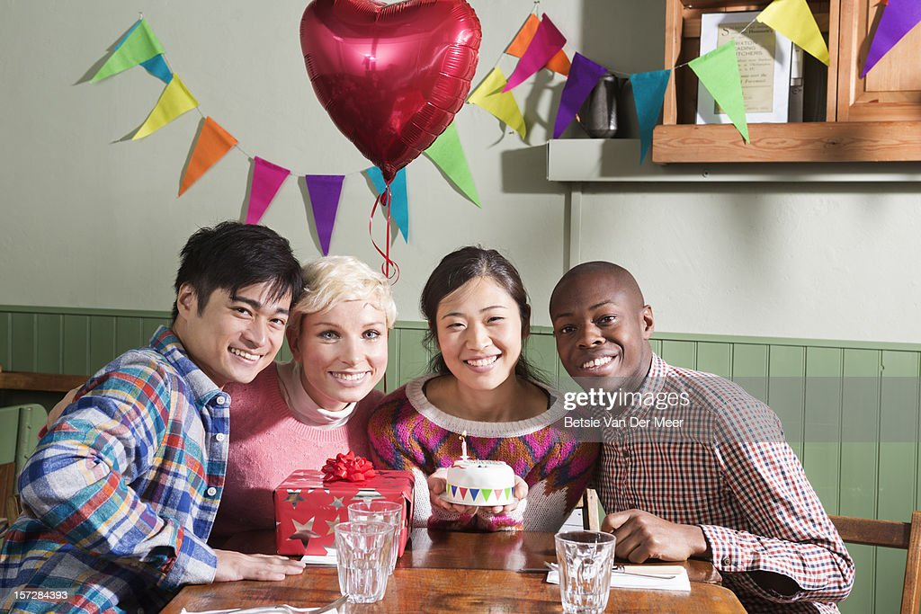 Groups of friends posing with birthday girl. : Stock Photo
