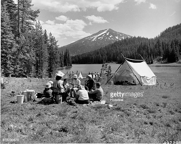 Groups of Girl Scouts camp on the shore of Todd Lake at the All-States Encampment, Deschutes National Forest, Oregon, 1960.