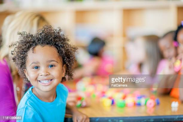 groups of kids in preschool stock photo - fatcamera stock pictures, royalty-free photos & images