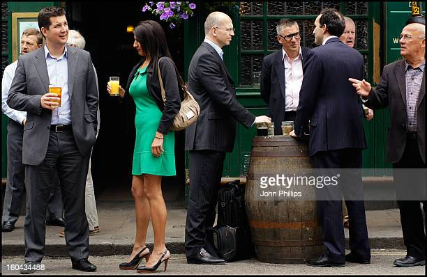 Groups of men and one woman drinking outside a pub at lunchtime, Borough Market, Southwark, London