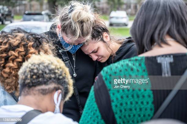 Groups of mourners cry while gathering for a prayer vigil at Olivet Missionary Baptist Church April 17, 2021 in Indianapolis, Indiana. The vigil was...