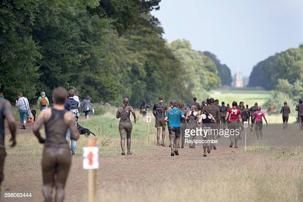 Groups of 'Mudders' running in Cirencester Park