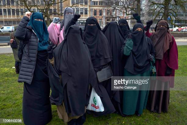 Groups of Muslim women wearing the niqab attend the demonstration against the law established by the government banning the use of the niqab in some...
