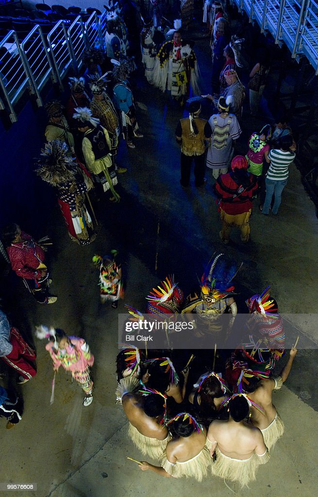 Groups of Native American dancers gather for the Grand Entry on the floor of the Verizon Center in Washington as the National Powwow gets underway on Friday, Aug. 10, 2007. The 3-days of drumming and dancing is organized by the Smithsonian National Museum of the American Indian.