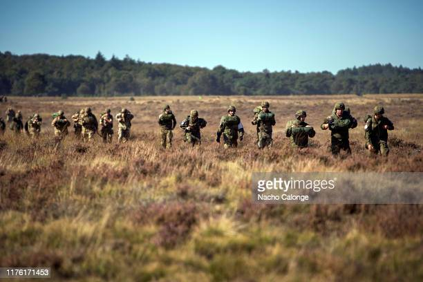 Groups of paratroopers from England, Holland, Germany, the United States, France, Italy, Poland and Canada return to the base after the jump on...