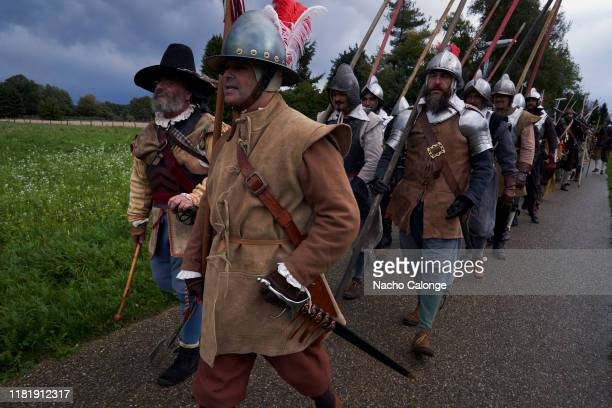 Groups of participants dressed as soldiers parade to begin the battle on October 18 2019 in Groenlo Netherlands For three days the streets of the...