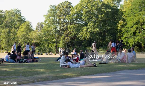 Groups of People are seen relaxing and socialising in Regent's Park on June 25, 2020 in London, United Kingdom. The UK is experiencing a summer...