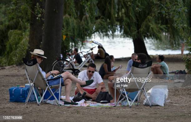 Groups of People are seen socialising in Regent's Park on June 26, 2020 in London, United Kingdom. The UK is experiencing a summer heatwave, with...