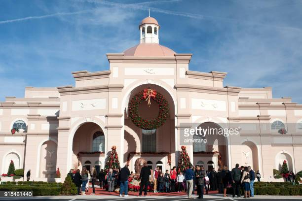 groups of people chatting or photographing outside sight & sound theaters decorated for christmas in lancaster - lancaster pennsylvania stock pictures, royalty-free photos & images