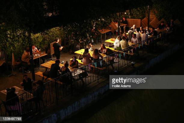 Groups of people drink in the beer garden at The Union Tavern, Westbourne Park, on September 13, 2020 in London, England. Concerned by rising cases...