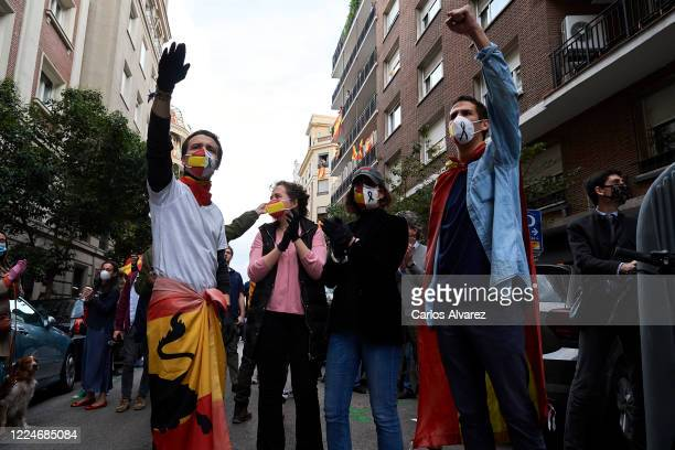 Groups of people participate with Spanish flags, hitting saucepans and shouts calling for the resignation of the government and against the...