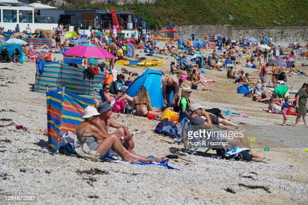 Groups of people relax in the sun on Gyllyngvase Beach on August 8 2020 in Falmouth Cornwall England The RNLI has called on beachgoers in the south...