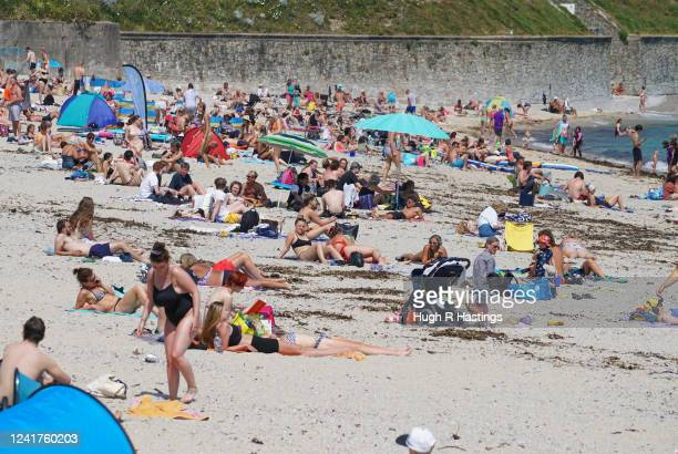 Groups of people relax in the sun on Gyllyngvase Beach on June 02 2020 in Falmouth Cornwall England The British government further relaxed Covid19...