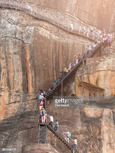 groups of people snaking up and down stairs to Sigiriya
