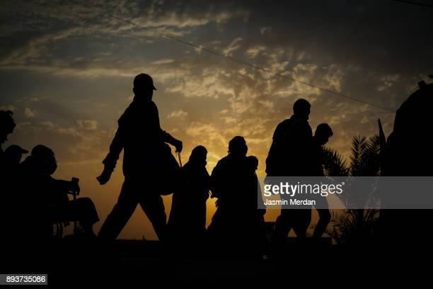 groups of people walking at sunset - religious occupation stock pictures, royalty-free photos & images