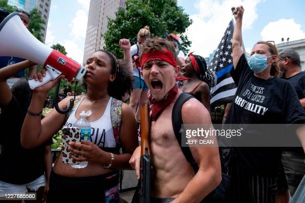 "Groups of protestors confront each other in front of the Ohio Statehouse during a right-wing protest ""Stand For America Against Terrorists and..."