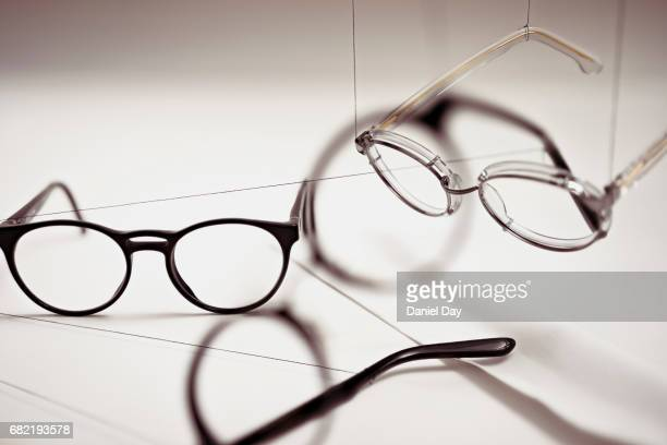 Groups of reading glasses hanging and suspended