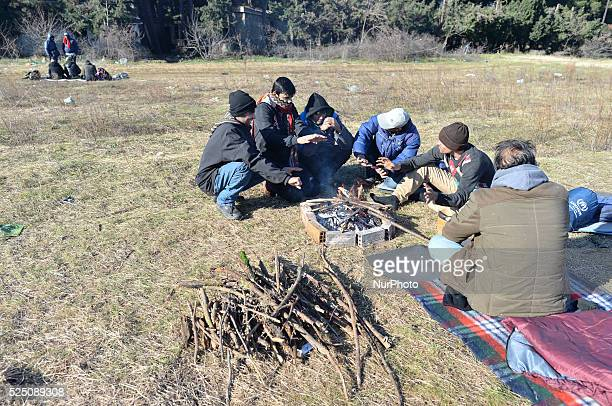 Groups of refugees seen near the border between Greece and the Republic of Macedonia . Since the 18 November, Macedonia – along with Serbia, Croatia...