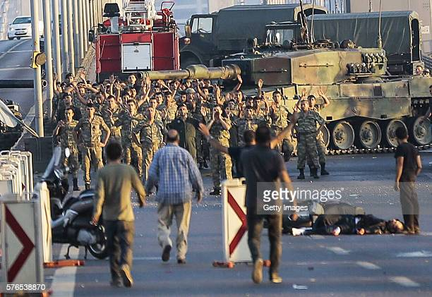 Groups of soldiers involved in the coup attempt in Turkey surrender on Istanbul's Bosphorus bridge with their hands raised on July 16 2016 in...