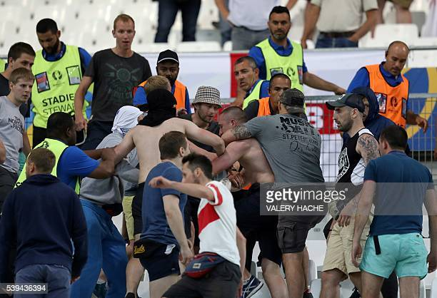 Groups of supporters clash fight at the end of the Euro 2016 group B football match between England and Russia at the Stade Velodrome in Marseille on...