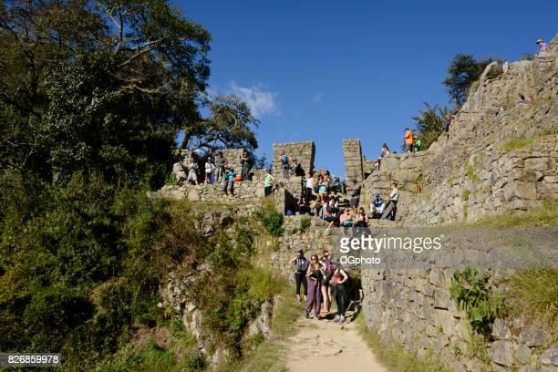 Groups of tourists at the Sun Gate, Machu Picchu, Peru