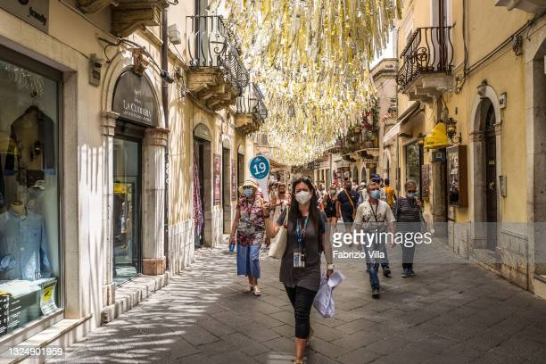Groups of tourists in Taormina's Corso Umberto on June 22, 2021 in Taormina, Italy. Tourists return to the hill-top town of Taormina near Mount Etna...