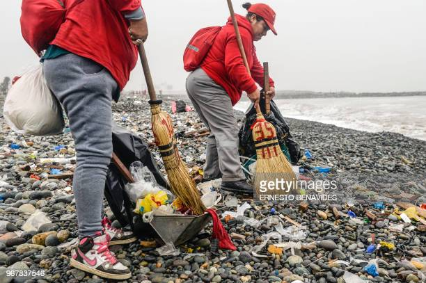 Groups of volunteers clean up plastic waste on a beach in Lima during the World Environment Day on June 5 2018 The UN urged to take steps against the...