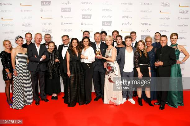Groupshot with the whole cast of the TV serie 'In aller Freundschaft' during the Goldene Henne winners board photo call on September 28, 2018 in...