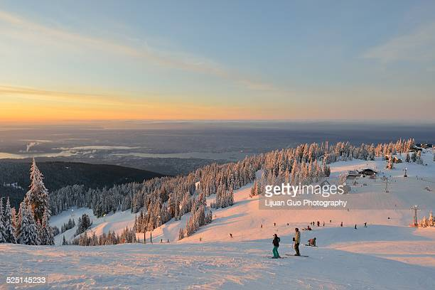 grouse mountain sunrise - grouse mountain stock photos and pictures