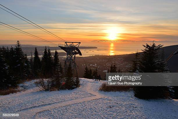 grouse mountain sunset - grouse mountain stock photos and pictures