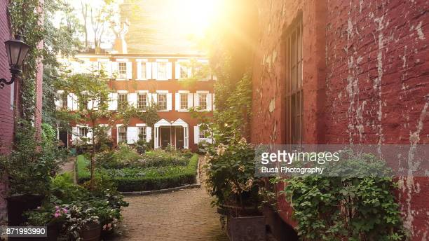 Grove Court, a small courtyard with 19th century townhouses in the West Village, Manhattan, New York City