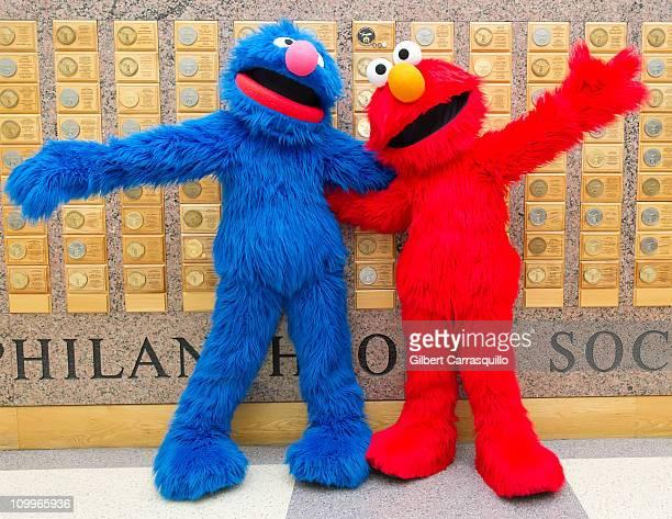 Grover and Elmo from 'Sesame Street' visit the Shriner's Hospital For Children on March 11, 2011 in Philadelphia, Pennsylvania.