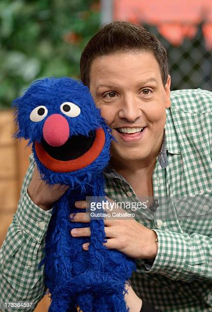 """Grover and Raul Gonzalez of Sesame Street hosts """"Despierta America"""" at Univision Headquarters on July 12, 2013 in Miami, Florida."""
