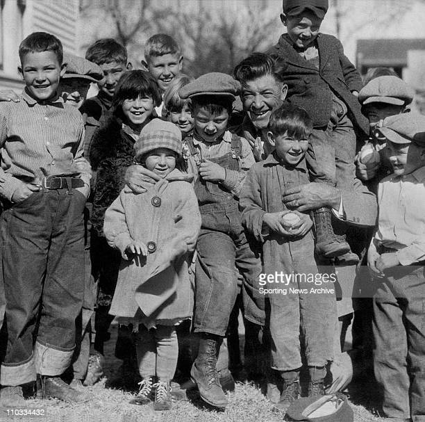 Grover Cleveland Alexander poses with a group of children in an undated file photo