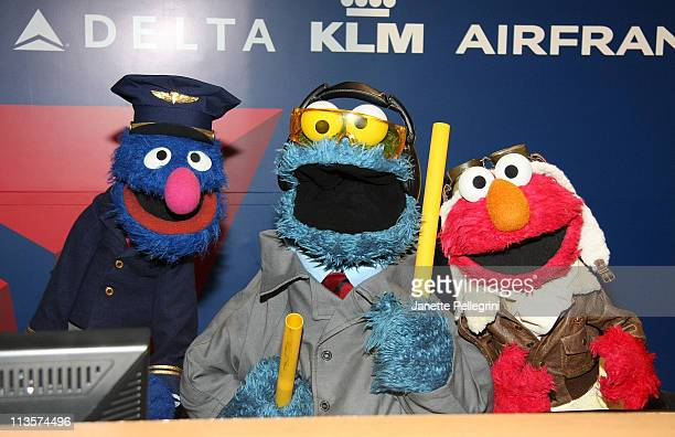 """Grover, Cookie Monster and Elmo attend the """"Elmo's Travel Songs and Games"""" DVD launch at LaGuardia Airport on May 3, 2011 in New York City."""
