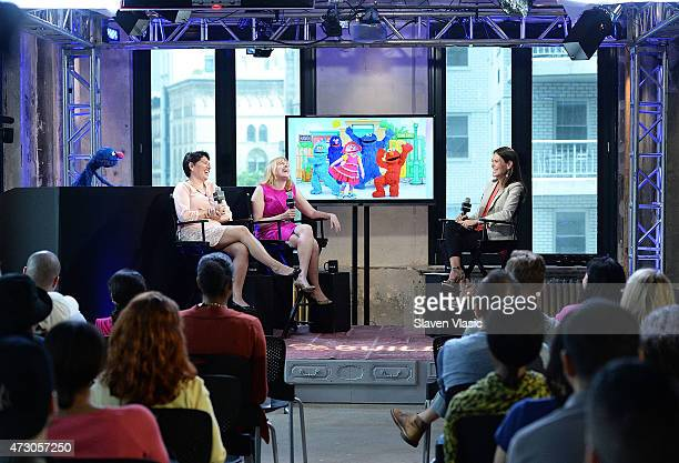 Grover of Sesame Street Dr Jeanette Betancourt and Rachel Tischler of the USO attend AOL Build Speaker Series 'Sesame Street's Grover And The USO Dr...