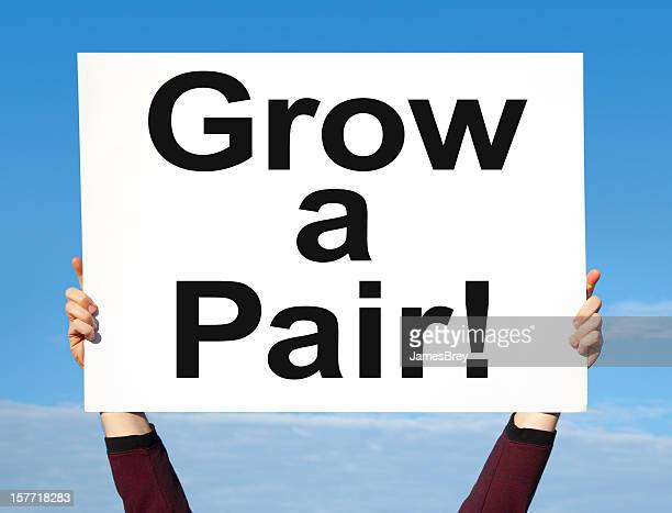 grow a pair sign - testis stock photos and pictures