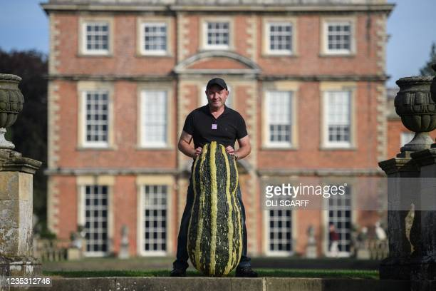 Grower John Simpson poses with his huge marrow weighing 65kg after it achieved 2nd place in the giant vegetable competition on the first day of the...