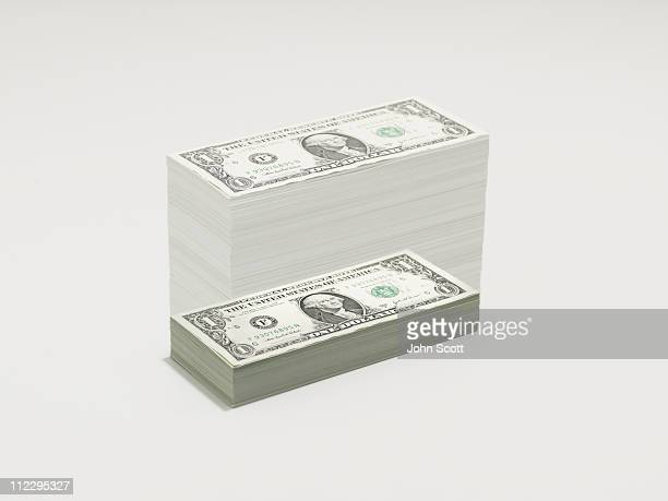 A growing pile of dollar bills