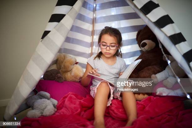 growing up with a love for reading - teepee stock pictures, royalty-free photos & images