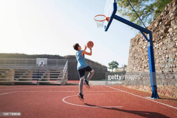 growing up with basketball - taking a shot sport stock pictures, royalty-free photos & images
