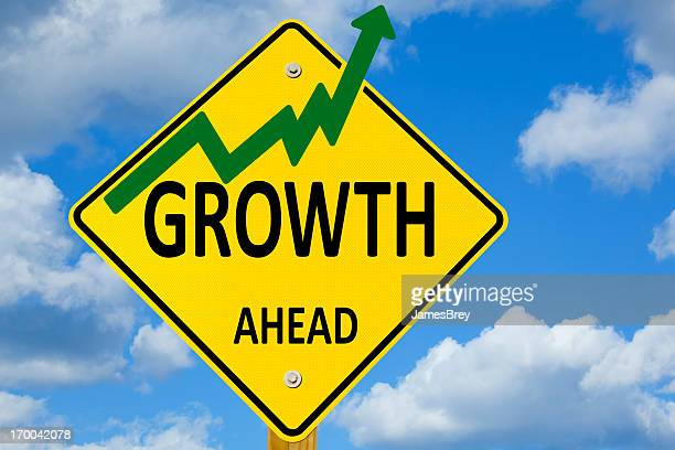 Growth Ahead Road Sign With Positive, Upward Chart