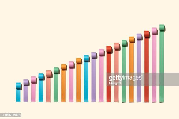 growth bar chart made of paper rolls - improvement stock pictures, royalty-free photos & images