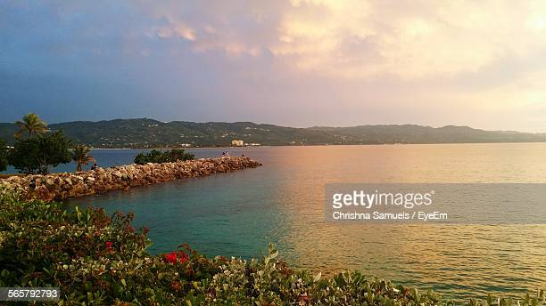groyne in sea at sunset - montego bay stock pictures, royalty-free photos & images