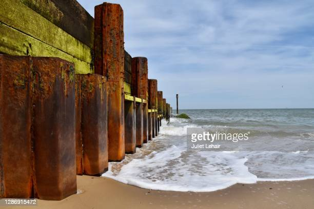 groyne sea defenses, south beach lowestoft, suffolk - weathered stock pictures, royalty-free photos & images