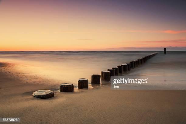 Groynes on the beach in a beautyful sunset